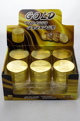 Infyniti Gold 4 parts Tobacco metal grinder in a display case