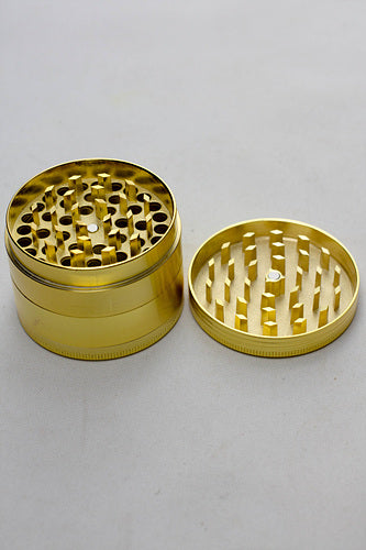 Infyniti Gold 4 parts Tobacco metal grinder in a display case - One wholesale Canada