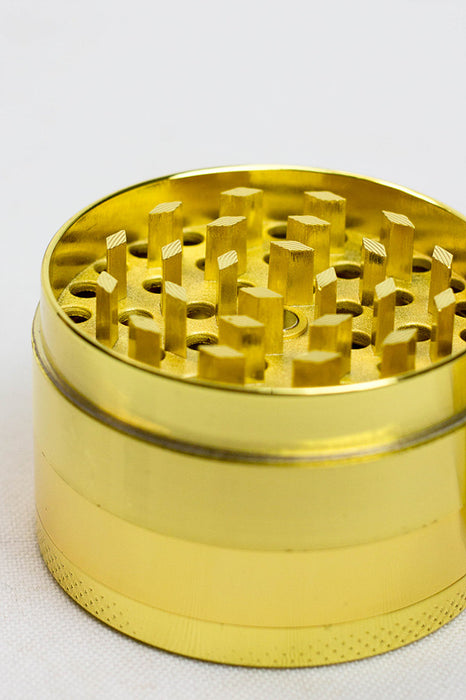 Gold 4 parts metal grinder in a display