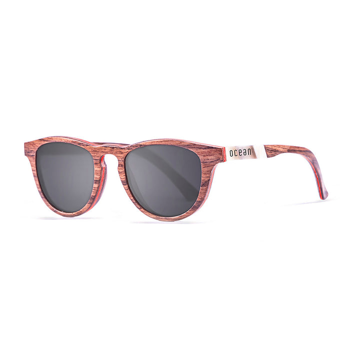 ocean sunglasses KRNglasses model AZORES SKU 54003.4 with walnut & turquoise line frame and smoke lens