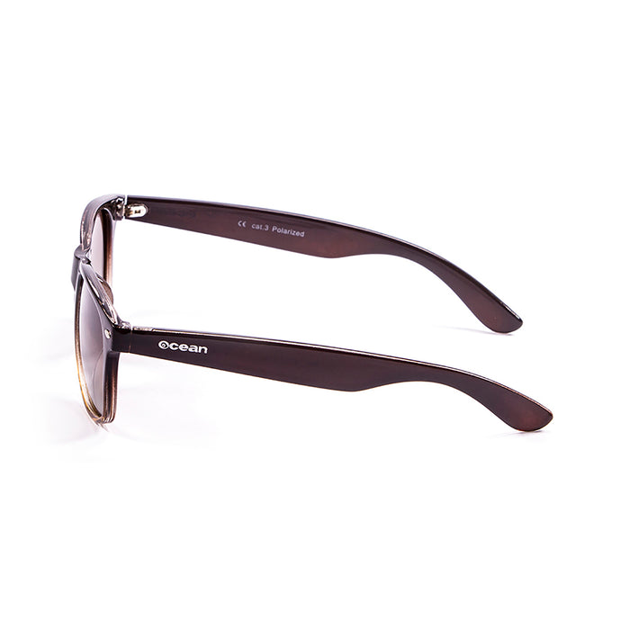 ocean sunglasses KRNglasses model BEACH SKU 18202.39 with transparent black frame and revo violet lens