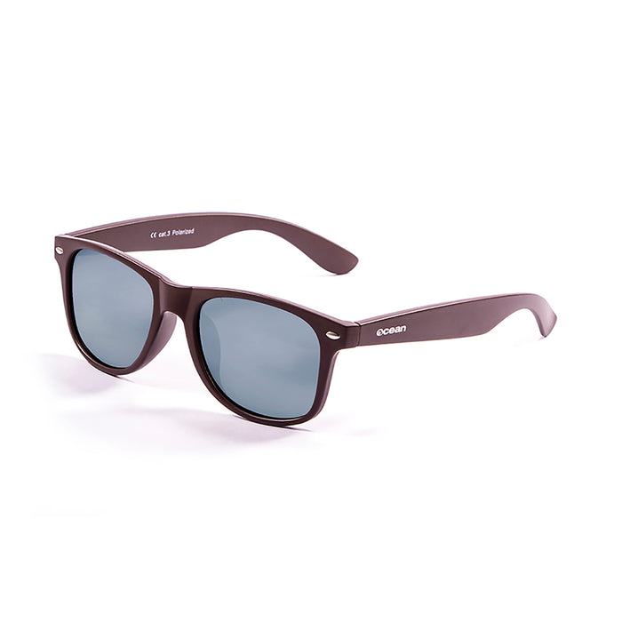 ocean sunglasses KRNglasses model BEACH SKU 18202.96 with transparent white frame and revo green lens