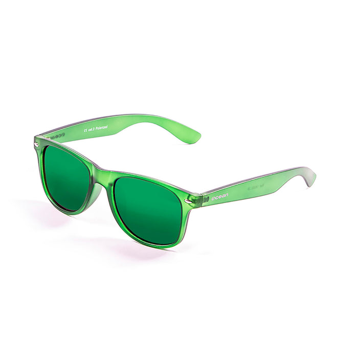 ocean sunglasses KRNglasses model BEACH SKU 18202.4 with shiny black frame and revo blue lens