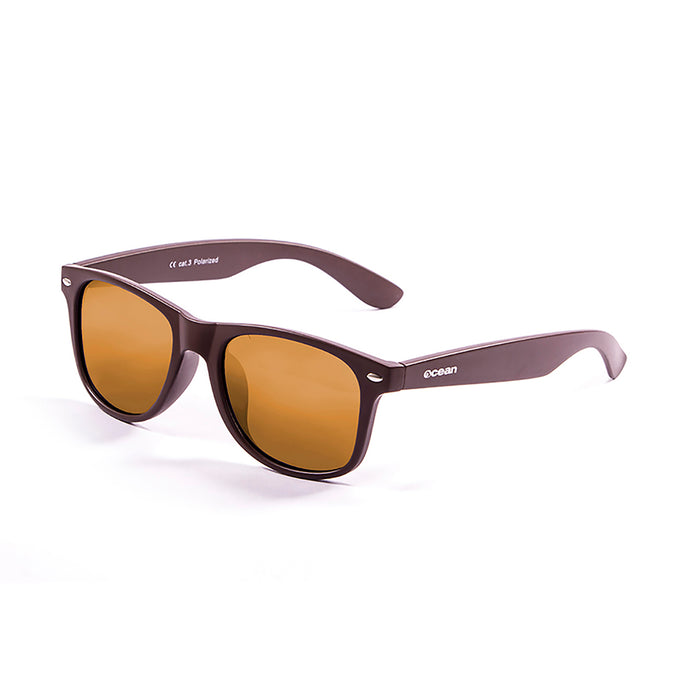 ocean sunglasses KRNglasses model BEACH SKU 18202.119 with matte black & blue frame and revo blue lens