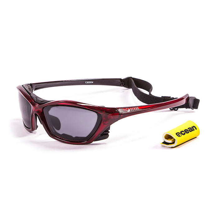 Ocean sunglasses model lake garda 13001.4 with red frame and revo red lens polarized eyewear for water sports