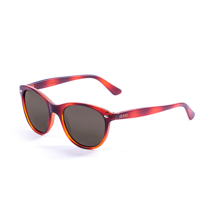 ocean sunglasses KRNglasses model LANDAS SKU 58000.1 with purple transparent frame and smoke lens
