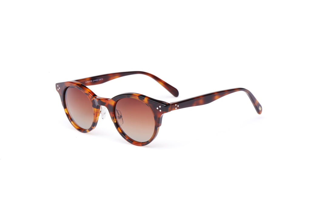 KYPERS sunglasses model LOLA LO004 with dark havana frame and gradient brown lens