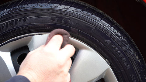 Applying Black Pearl Trim & Tire Armour in a Tray Applying to Tires with the roller