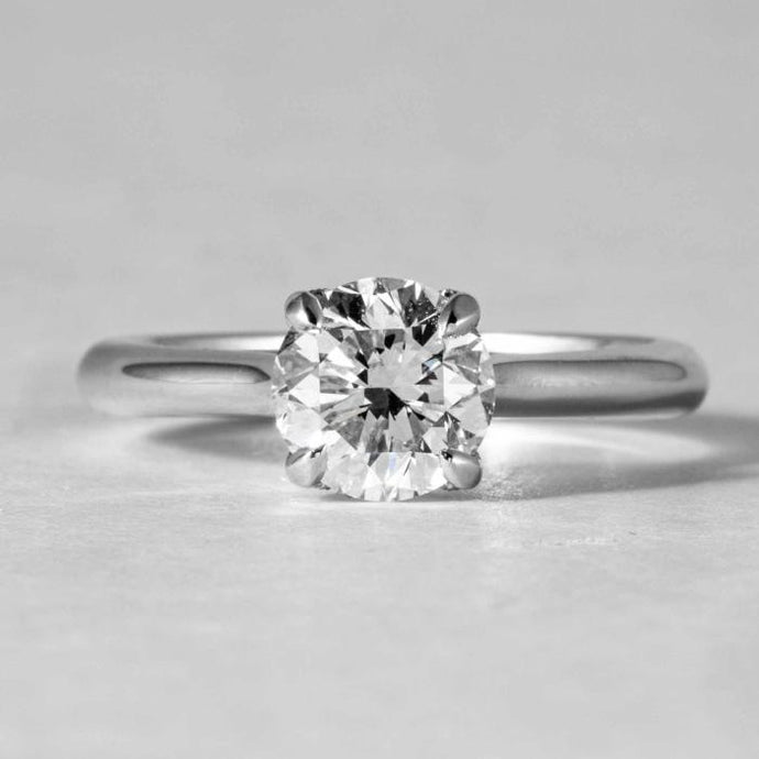 18 kt wg solitaire engagement ring. Consisting of 1.41 Round E/SI2 GIA Diamond - Boston