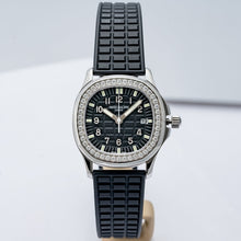 Load image into Gallery viewer, Patek Philippe Ladies Aquanaut Stainless Steel 35.6mm (5067A-001) - Boston