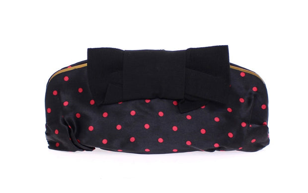 Black polka dotted silk clutch