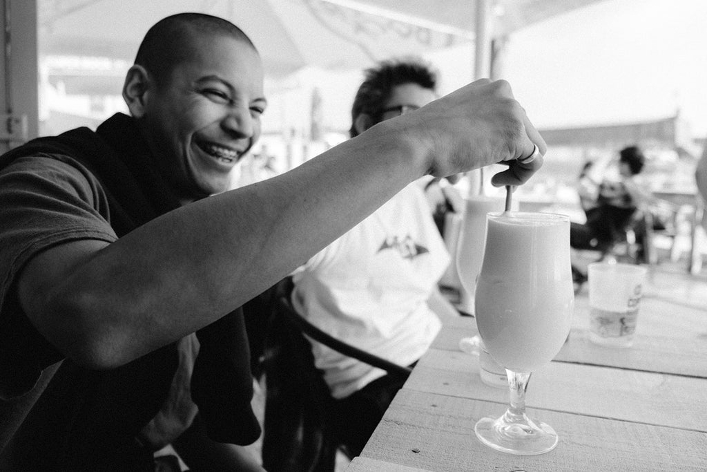 Louie Smiling With Drink Black & White
