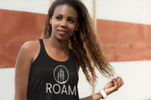 Load image into Gallery viewer, Roam black adventure tank top on woman of color