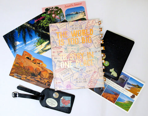 (Image) Travel journal surrounded by vintage postcards
