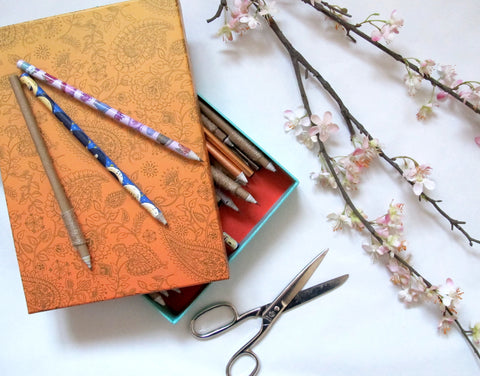 (Image) Box of decorated pencils.