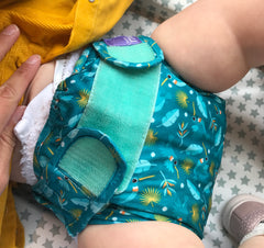 Baby on change mat in cloth nappy