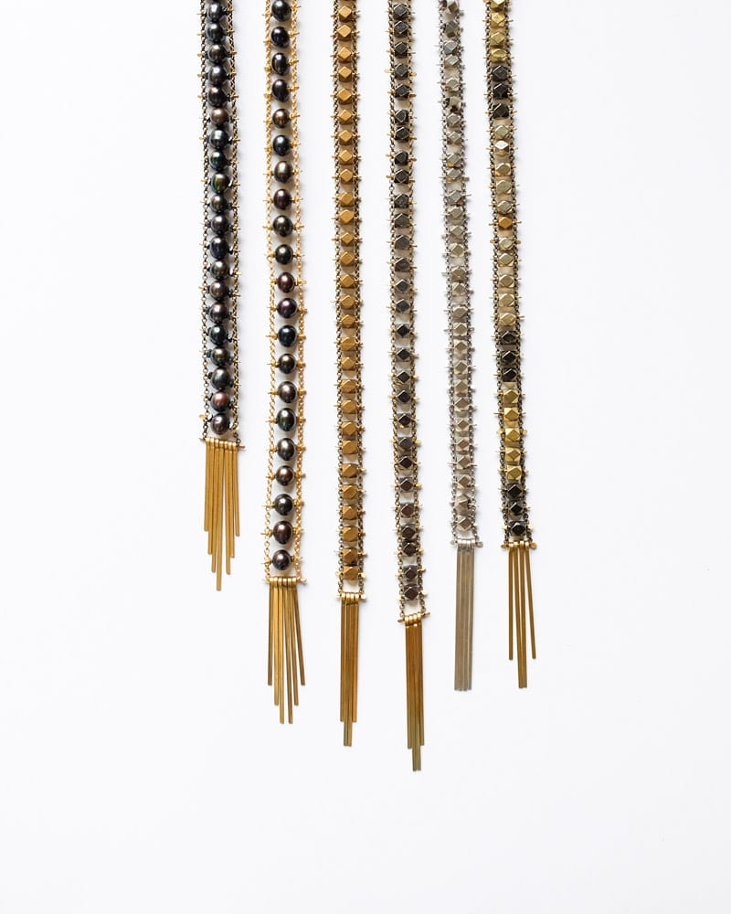 6 Demimonde handcrafted brass beaded necklaces with tassels