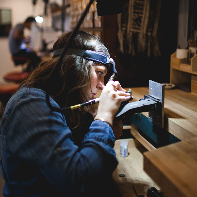 Jewelry designer Betsy Cross at her bench