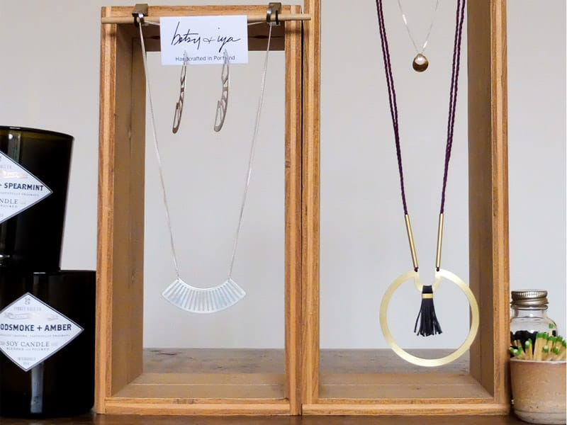 betsy & iya jewelry display earring and necklace pairings