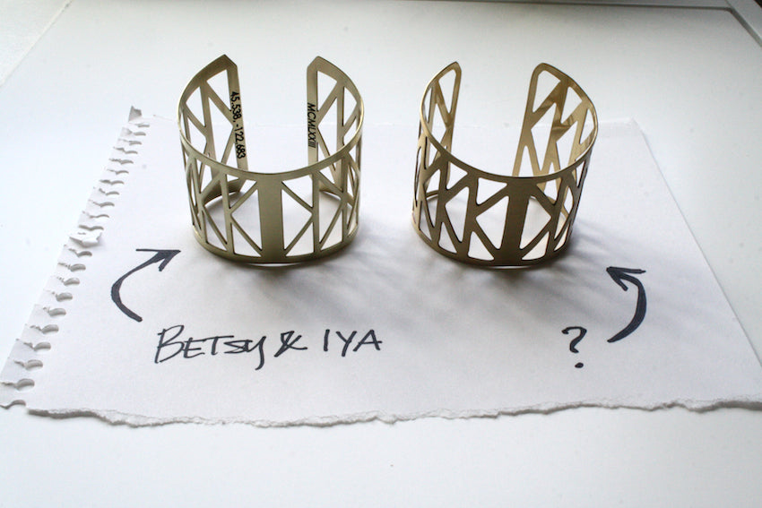 A comparison of two virtually identical looking cuff bracelets. One is designed and made by betsy & iya in Portland, Oregon. The other we believe to be a copy of the original design.