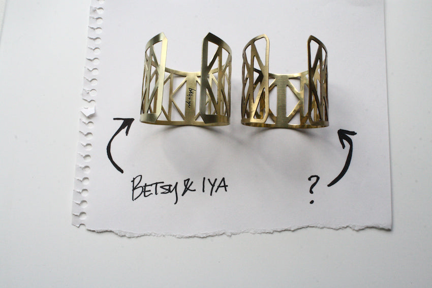 An image showing the interior of the betsy & iya Fremont Bridge cuff bracelet with the other being what we think is a copy of the design.