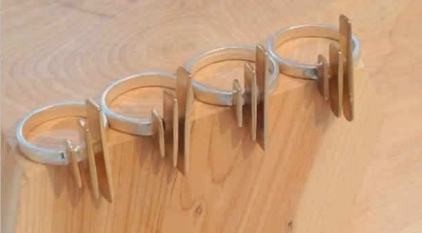 silver banded ring with vertical cast bronze bars