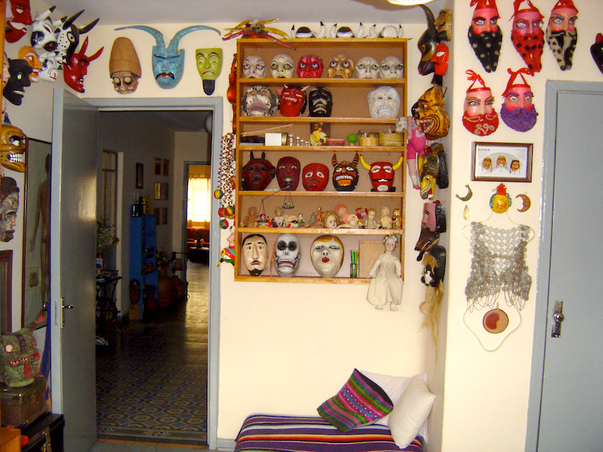 Multiple Mexico masks, old and new, hang on the walls and on the shelves of Alicia Martinez Alvarez's home in Mexico City.