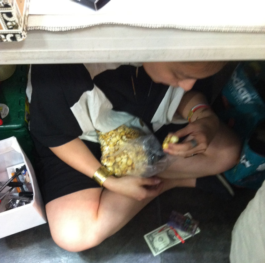 Don't mind me. Just taking a little break under the table and eating some of the tasty kettle corn being sold at the event.