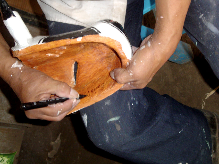 The working hands of a master tradition wooden mask maker in Veracruz.