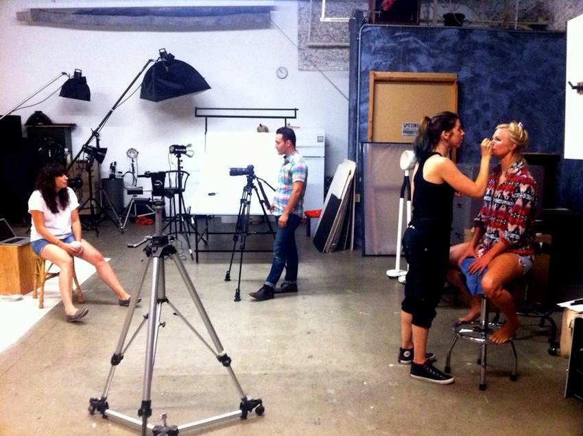 Behind the scenes at a fashion photo shoot.