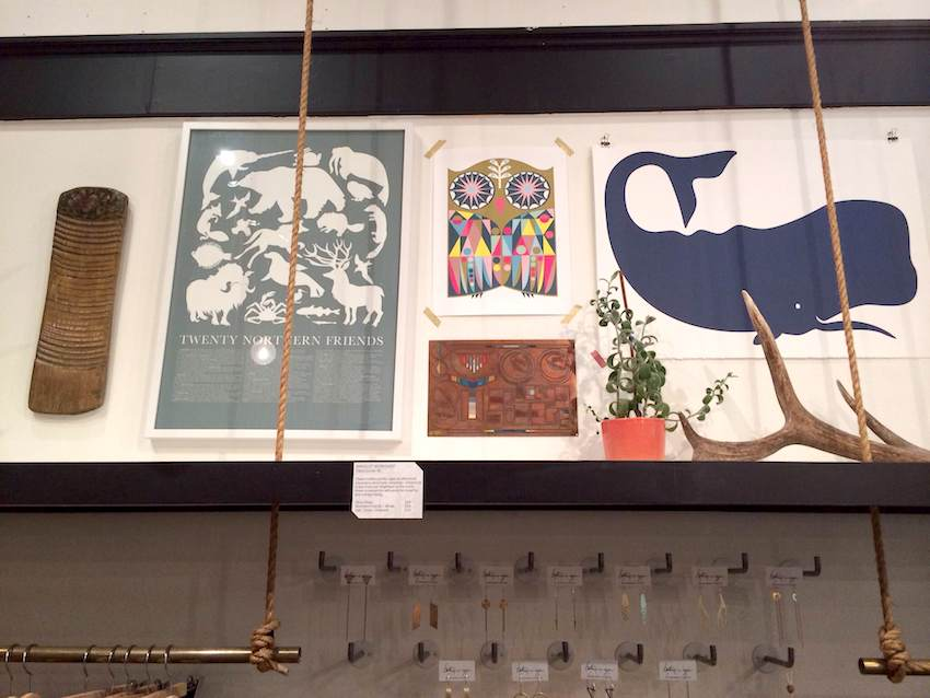 A picture of framed art and plants at the betsy & iya brick & mortar location.