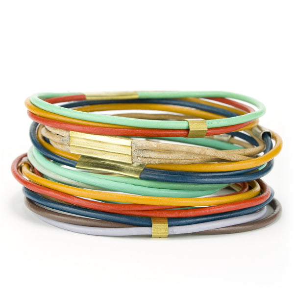 A large stack of all the different leather bangle bracelet colors betsy & iya offers.