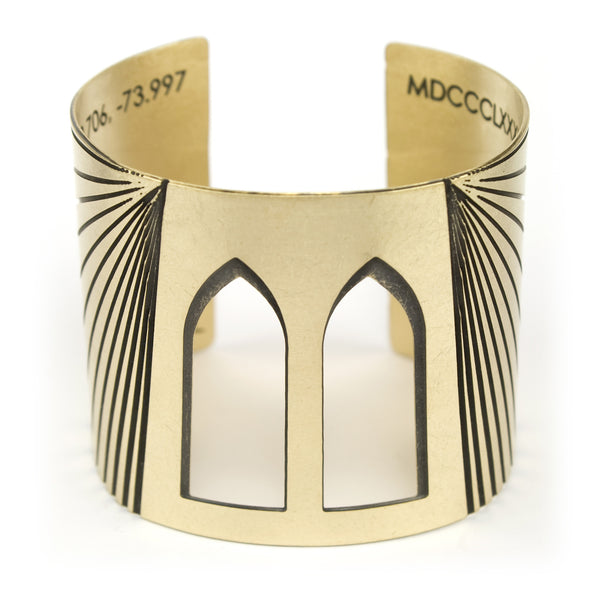 betsy & iya Brooklyn Bridge cuff bracelet with arch cutouts and gold and black brass.