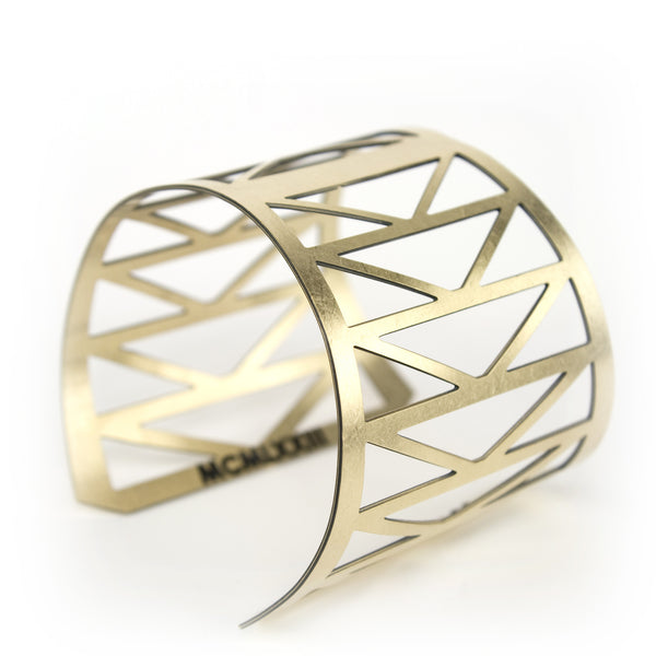 betsy & iya Fremont Bridge cuff with triangular geometric cutouts.