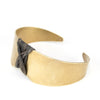 betsy & iya Arch's Shadow cuff bracelet with gray leather.