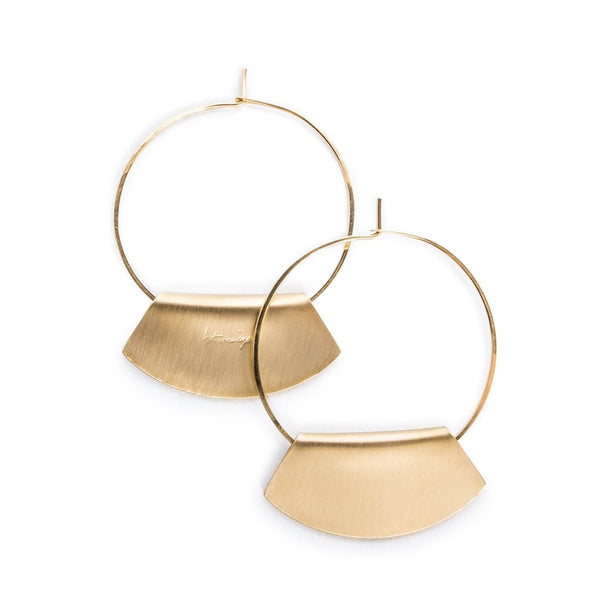 Hand-formed hoop earrings of 14k gold-fill wire, with folded, fan-shaped, 14k gold-filled pendants, engraved with the betsy & iya logo. Hand-crafted in Portland, Oregon.