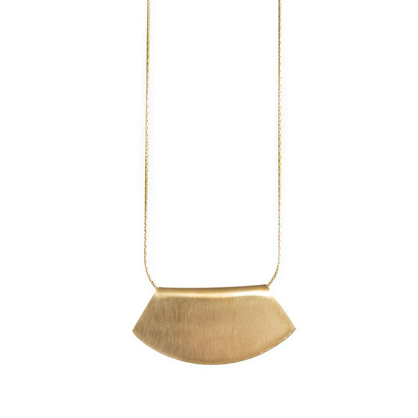 Delicate 14k gold-filled chain threaded through a fan-shaped 14k gold-filled pendant, engraved on one side with the betsy & iya logo. Hand-crafted in Portland, Oregon.