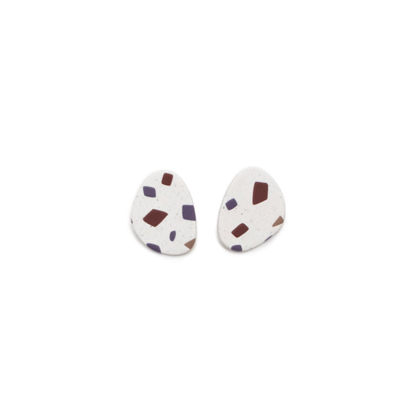 A pair of round polymer clay earrings with a brown/mauve and purple terrazzo pattern. Designed and crafted in Portland, Oregon by The Baked Clay Studio.