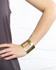 Brooklyn Bridge cuff bracelet pictured on a model's arm for scale.