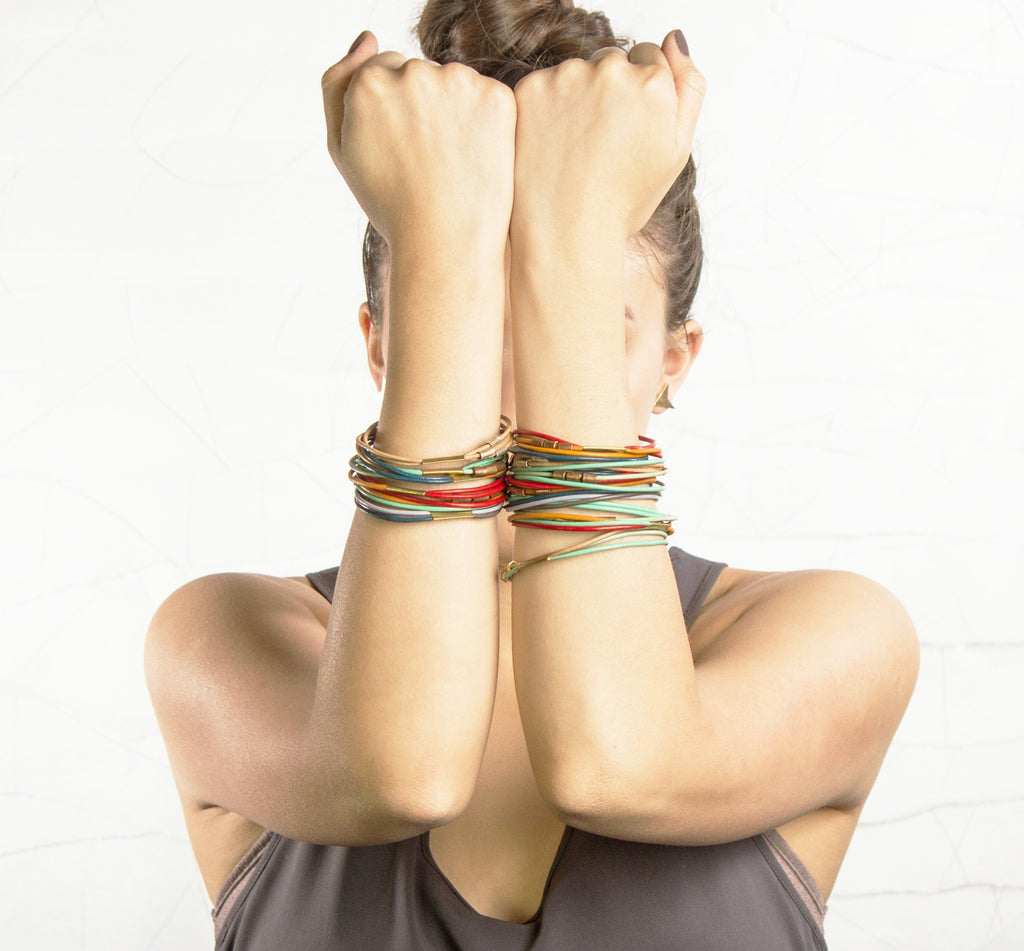 Multiple strands of colorful leather make up this stylish bangle ...