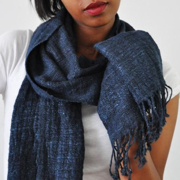 "Model wears Eri Silk Scarf in Midnight. 100% Ethiopian Eri silk. Measures 72""x16""."