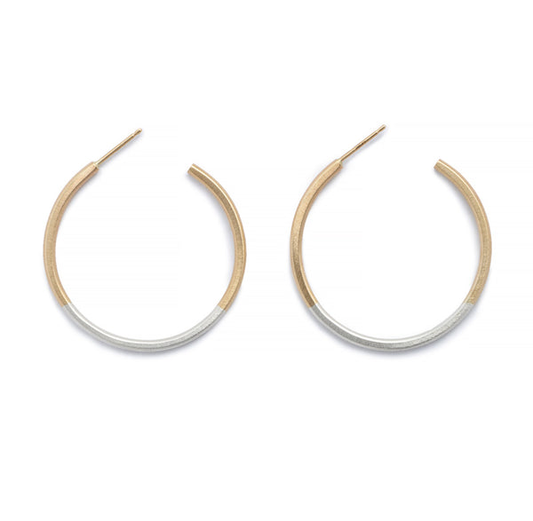 Minimalist, lightweight, mixed metal hoops of 14k yellow gold and sterling silver hand-forged wire, with 14k gold earring posts. Size small, one and one-eighth inches in diameter. Hand-crafted in Portland, Oregon.