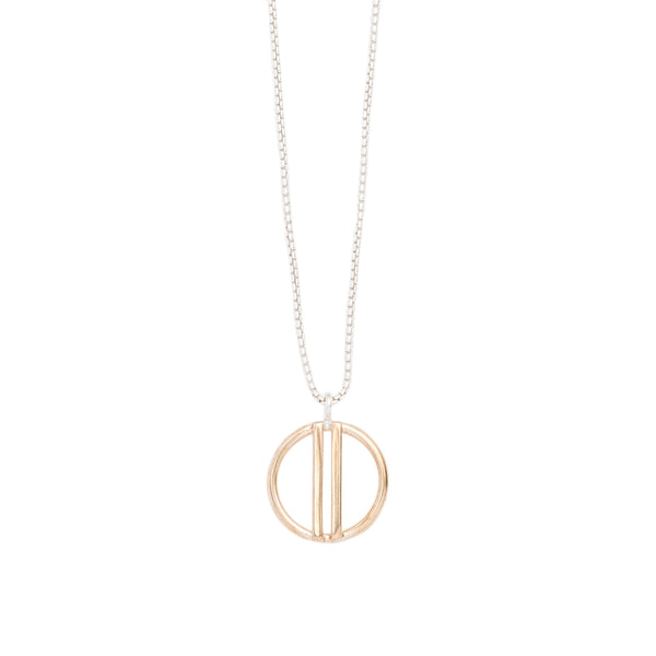 Small, open circle pendant of shiny cast bronze with two vertical bars running through the center, on a sterling silver box chain. Hand-crafted in Portland, Oregon.