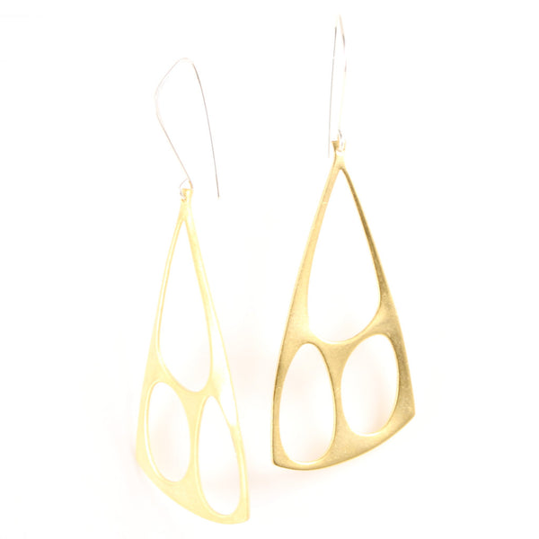 Architectural brass shapes hang from handcrafted silver earring components.