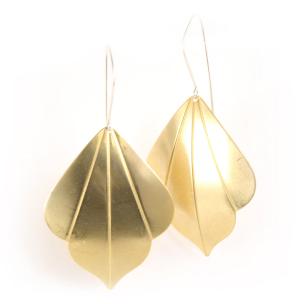 Bright golden deco shapes dangle from silver ear wires.