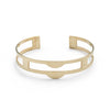 Edgy, lightweight, and adjustable cuff bracelet of polished brass, with three rectangular cutouts through the center of the cuff and two semicircle-shaped peaks at the front of the cuff. Hand-crafted in Portland, Oregon.