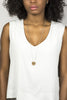 The long version of the cast-bronze and sterling silver Ayni necklace, worn by a model with a white tank top.