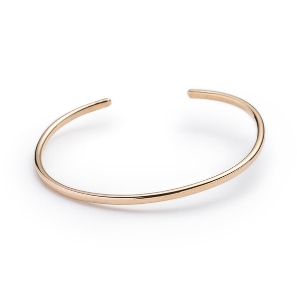 Classic, simple, and adjustable stacking cuff of hand-forged brass wire, with etched notch details on both ends of the cuff. Hand-crafted in Portland, Oregon.
