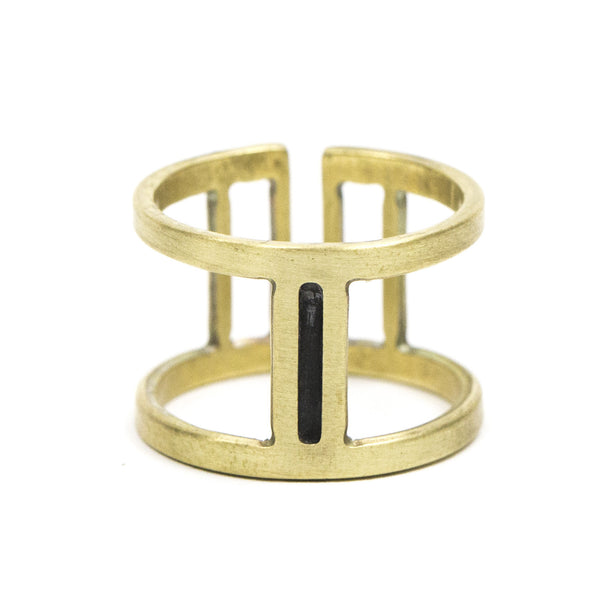 Wide, adjustable brass ring with large, rectangular cutouts surrounding a slim, oxidized center piece. Hand-crafted in Portland, Oregon.