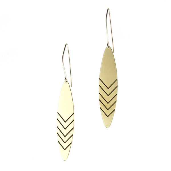 Brass earrings with cascading chevron patterns by betsy & iya.
